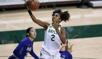 Baylor guard DiDi Richards (2) goes up for a shot as McNeese guard Shaela Gardner, left, and guard Kyla Hamilton, rear, defend in the first half of an NCAA college basketball game in Waco, Texas, Saturday, Dec. 19, 2020. (AP Photo/Tony Gutierrez)
