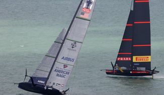 U.S. yacht American Magic, left, and Italy's Luna Rossa compete in the America's Cup World Series on the Hauraki Gulf off Auckland, New Zealand, Friday, Dec. 18, 2020. (New Zealand Herald via AP)