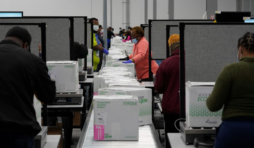 Boxes containing the Moderna COVID-19 vaccine are prepared in Olive Branch, Mississippi, on Sunday. The first boxes are set to arrive Monday. (Associated Press)
