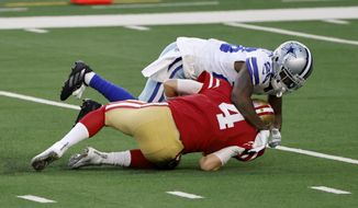 Dallas Cowboys cornerback Jourdan Lewis (26) sacks San Francisco 49ers quarterback Nick Mullens (4) in the first half of an NFL football game in Arlington, Texas, Sunday, Dec. 20, 2020. (AP Photo/Ron Jenkins)