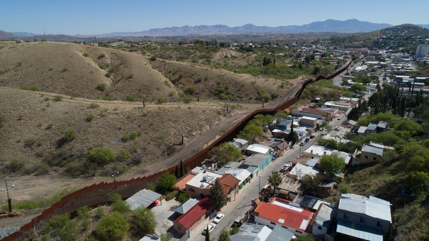 U.S. Mexico border fence as it cuts through the two downtowns of Nogales. (AP Photo/Brian Skoloff, File)