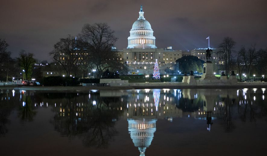 The U.S. Capitol is seen at night after negotiators sealed a deal for COVID relief, Sunday, Dec. 20, 2020, in Washington. Top Capitol Hill negotiators sealed a deal Sunday on an almost $1 trillion COVID-19 economic relief package, finally delivering long-overdue help to businesses and individuals and providing money to deliver vaccines to a nation eager for them. (AP Photo/Jose Luis Magana.