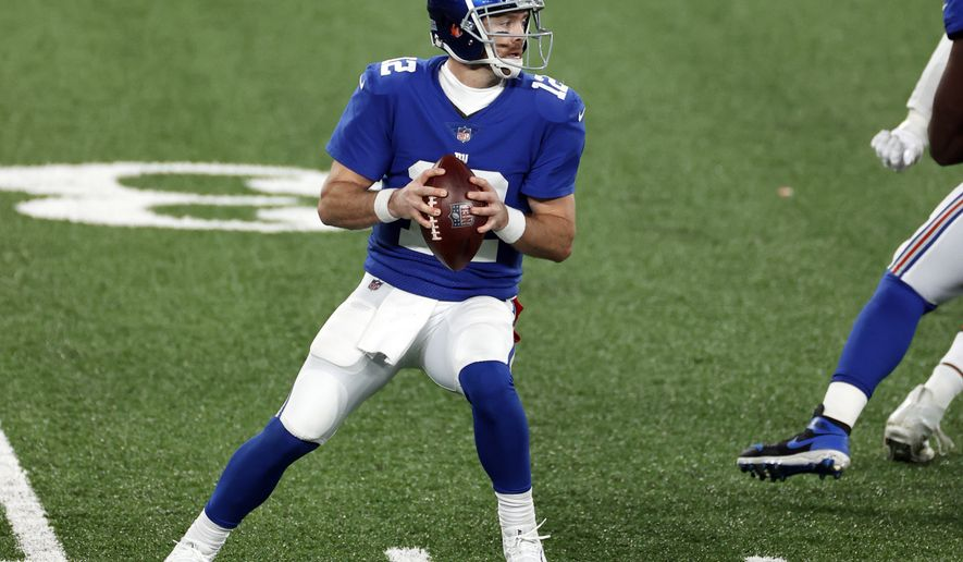 New York Giants quarterback Colt McCoy (12) in action during an NFL football game against the Cleveland Browns, Sunday, Dec. 20, 2020, in East Rutherford, N.J. (AP Photo/Adam Hunger)