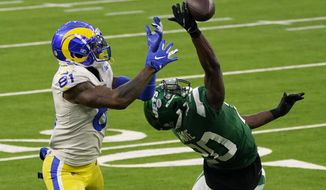 New York Jets free safety Marcus Maye, right, breaks up a pass intended for Los Angeles Rams tight end Gerald Everett (81) during the second half of an NFL football game Sunday, Dec. 20, 2020, in Inglewood, Calif. (AP Photo/Ashley Landis)