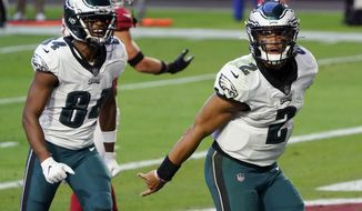 Philadelphia Eagles quarterback Jalen Hurts (2) celebrates his touchdown against the Arizona Cardinals during the second half of an NFL football game, Sunday, Dec. 20, 2020, in Glendale, Ariz. (AP Photo/Rick Scuteri)