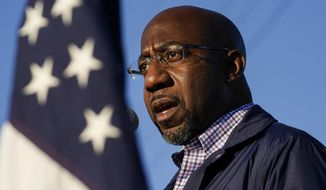 In this Nov. 15, 2020, file photo Raphael Warnock, a Democratic candidate for the U.S. Senate, speaks during a campaign rally in Marietta, Ga. As the head of the Atlanta church where Martin Luther King Jr. preached, Warnock has not shied away from impassioned sermons and forceful advocacy on behalf of the poor and disadvantaged. The 51-year-old now wants to take that progressive platform to the U.S. Senate. He is running to unseat one of Georgia's Republican senators, Kelly Loeffler, in the Jan. 5 race.  (AP Photo/Brynn Anderson, File)