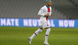 PSG's Kylian Mbappe runs onto the pitch during the French League One soccer match between Lille and Paris Saint-Germain at the Stade Pierre Mauroy stadium in Villeneuve d'Ascq, northern France Sunday, Dec. 20, 2020. (AP Photo/Michel Spingler)