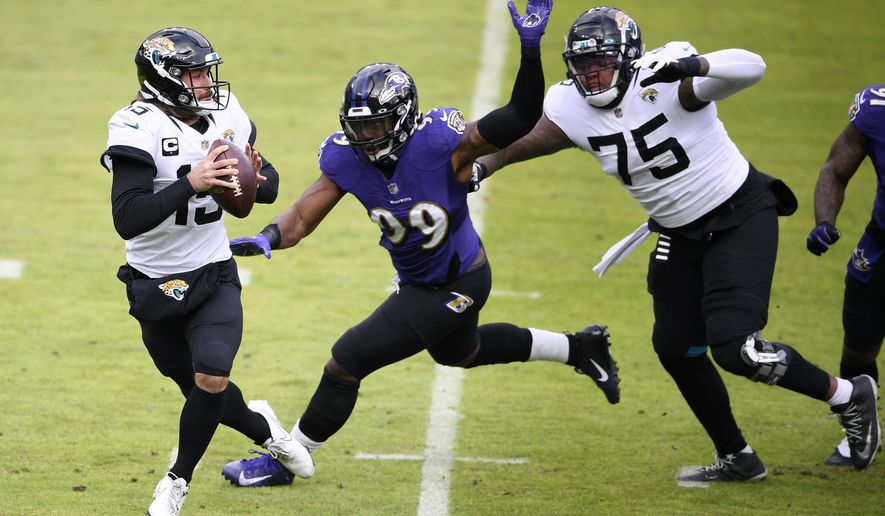 Baltimore Ravens linebacker Matthew Judon (99) gets by Jacksonville Jaguars offensive tackle Jawaan Taylor (75) as quarterback Gardner Minshew II (15) looks to throw a pass during the first half of an NFL football game, Sunday, Dec. 20, 2020, in Baltimore. (AP Photo/Nick Wass)