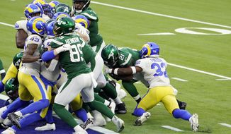 New York Jets running back Frank Gore (21) runs into the end zone for a touchdown against the Los Angeles Rams during the second half of an NFL football game Sunday, Dec. 20, 2020, in Inglewood, Calif. (AP Photo/Jae C. Hong)