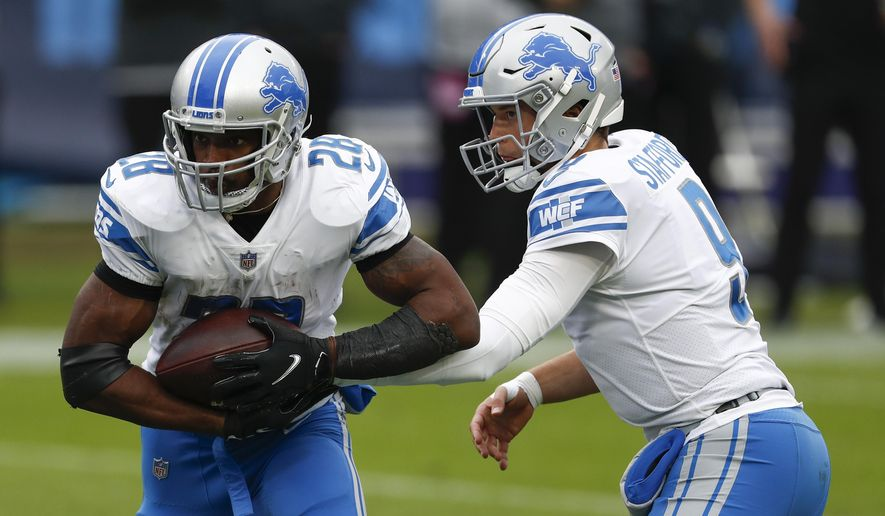 Detroit Lions quarterback Matthew Stafford hands off to the running back Adrian Peterson during the first half of an NFL football game Sunday, Dec. 20, 2020, in Nashville, N.C. (AP Photo/Wade Payne)