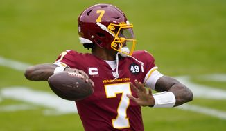 Washington Football Team quarterback Dwayne Haskins (7) as he prepares to throw the ball against the Seattle Seahawks during the first half of an NFL football game, Sunday, Dec. 20, 2020, in Landover, Md. (AP Photo/Mark Tenally)