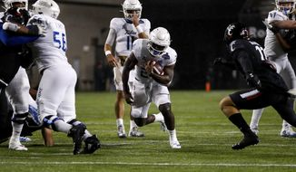Tulsa running back Corey Taylor II (24) carries the ball during the first half of the American Athletic Conference championship NCAA college football game against Cincinnati, Saturday, Dec. 19, 2020, in Cincinnati. (AP Photo/Aaron Doster)