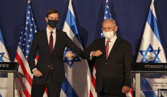 White House senior adviser Jared Kushner, left, elbow bumps Israeli Prime Minister Benjamin Netanyahu during a news conference in Jerusalem, Monday, Dec. 21, 2020. (Ronen Zvulun/Pool Photo via AP)