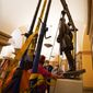 This Monday, Dec. 21, 2020, photo provided by the Office of the Governor of Virginia shows workers removing a statue of Confederate Gen. Robert E. Lee from the National Statuary Hall Collection in Washington. The statue that has represented Virginia in the U.S. Capitol for 111 years has been removed after a state commission decided that Lee was not a fitting symbol for the state. (Jack Mayer/Office of Governor of Virginia, File)