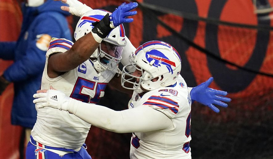 Buffalo Bills defensive end Jerry Hughes, left, celebrates with teammate defensive tackle Harrison Phillips after scoring a touchdown off a fumble recovery during the second half of an NFL football game against the Denver Broncos, Saturday, Dec. 19, 2020, in Denver. (AP Photo/Jack Dempsey)