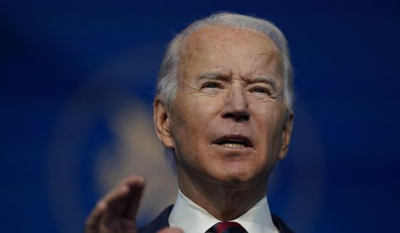 President-elect Joe Biden announces his climate and energy nominees and appointees at The Queen Theater in Wilmington Del., Saturday, Dec. 19, 2020. (AP Photo/Carolyn Kaster)