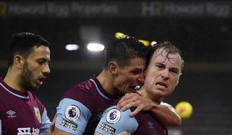 Burnley's Ashley Barnes, right, celebrates with teammates after scoring his side's opening goal during the English Premier League soccer match between Burnley and Wolverhampton Wanderers at the Turf Moor stadium in Burnley, England, Monday, Dec. 21, 2020. (Gareth Copley/Pool via AP)