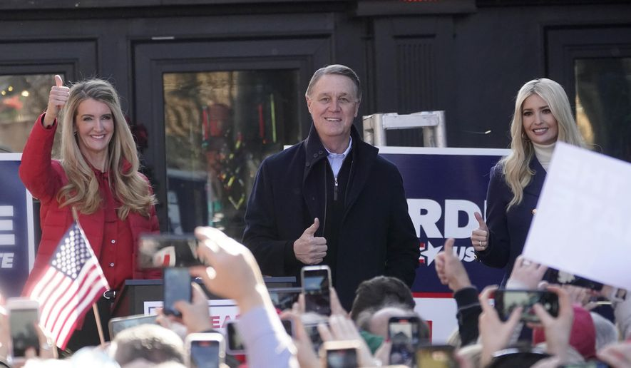 Sen. Kelly Loeffler, R-Ga., left, stands with Sen. David Perdue, R-Ga., and Ivanka Trump, assistant to the President, during a campaign rally, Monday, Dec. 21, 2020, in Milton, Ga. (AP Photo/John Bazemore) **FILE**