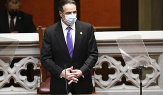 New York Gov. Andrew Cuomo speaks to members of New York state's Electoral College before voting for president and vice president in the Assembly Chamber at the state Capitol in Albany, N.Y., Monday, Dec. 14, 2020. (AP Photo/Hans Pennink, Pool)