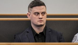 Jesse Shane Kempson sits in the High Court on Nov. 4, 2019, during the trial for the murder of British backpacker Grace Millane in Auckland, New Zealand. The New Zealand man who murdered a British tourist two years ago has been identified as the attacker in assaults on two other women. (Michael Craig/NZ Herald via AP)