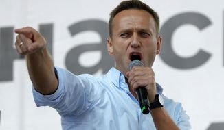 FILE - In this Saturday, July 20, 2019 file photo, Russian opposition activist Alexei Navalny gestures while speaking to a crowd during a political protest in Moscow, Russia. Russian opposition leader Alexei Navalny on Monday Dec. 21, 2020, released a recording of a phone call he said he made to an alleged state security operative who revealed details of how the politician was poisoned. (AP Photo/Pavel Golovkin, File)