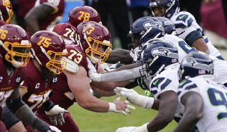 The line of scrimmage during the second half of an NFL football game between the Seattle Seahawks and Washington Football Team, Sunday, Dec. 20, 2020, in Landover, Md. (AP Photo/Mark Tenally)