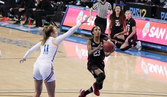 Stanford guard Kiana Williams (23) drives past UCLA forward Emily Bessoir during the first half of an NCAA college basketball game Monday, Dec. 21, 2020, in Los Angeles. (AP Photo/Marcio Jose Sanchez)