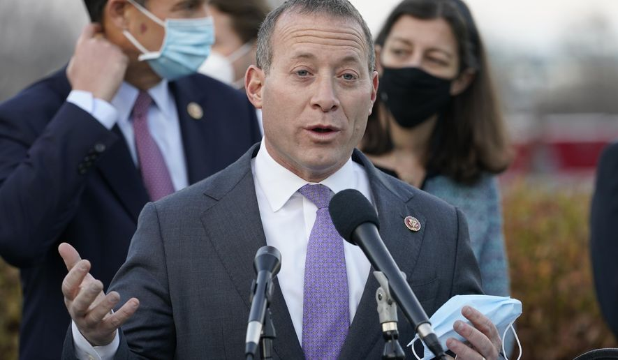 Problem Solvers Caucus co-chair Rep. Josh Gottheimer, D-N.J., speaks to the media with members of his caucus about the expected passage of the emergency COVID-19 relief bill, Monday, Dec. 21, 2020, on Capitol Hill in Washington. (AP Photo/Jacquelyn Martin) ** FILE **