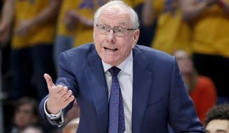 In this Feb. 26, 2020, file photo, Syracuse head coach Jim Boeheim instructs his team as they play against Pittsburgh during the first half of an NCAA college basketball game in Pittsburgh. Boeheim is among the coaches 65 and up who have contracted COVID-19, which can be a greater threat the older you are. (AP Photo/Keith Srakocic, File)