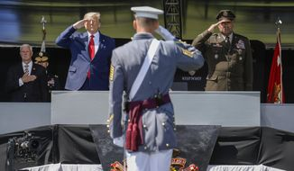 FILE - In this June 13, 2020 photo, President Donald Trump, left, and the United States Military Academy superintendent Darryl A. Williams, right, salute graduating cadets as the national anthem is played during commencement ceremonies in West Point, N.Y. More than 70 West Point cadets have been accused of cheating on a math exam taken online when they were studying remotely because of the coronavirus pandemic. A spokesman at the U.S. Military Academy says 55 cadets admitted cheating on the calculus exam in May. (AP Photo/John Minchillo, Pool)