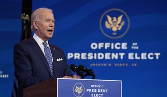 President-elect Joe Biden speaks at The Queen Theater in Wilmington, Del., Tuesday, Dec. 22, 2020. (AP Photo/Carolyn Kaster)