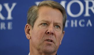 Georgia Gov. Brian Kemp speaks during a news conference on vaccines for COVID-19 at Emory Health Care Tuesday, Dec. 22, 2020, in Atlanta. (AP Photo/John Bazemore) **FILE**