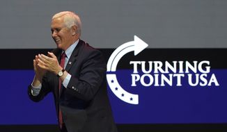 Vice President Mike Pence arrives on stage to speak during the Turning Point USA Student Action Summit, Tuesday, Dec. 22, 2020, in West Palm Beach, Fla. (AP Photo/Lynne Sladky)