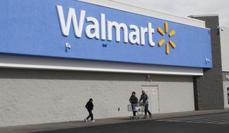 People shop at a Walmart Thursday, Feb. 6, 2020, in El Paso, Texas. (AP Photo/Cedar Attanasio) ** FILE **