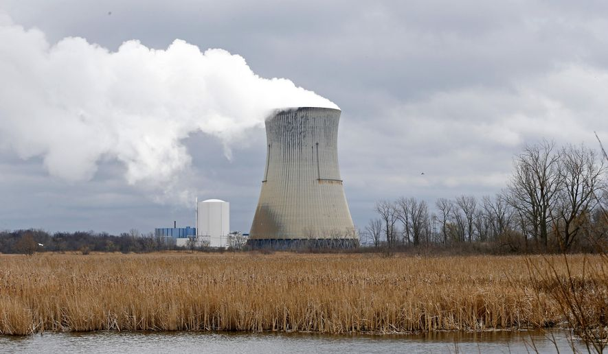 This April 4, 2017, photo shows the then-FirstEnergy Corp.'s Davis-Besse Nuclear Power Station in Oak Harbor, Ohio. The fate of the legislation that aimed to bail out Ohio's two nuclear plants remains unclear as the Legislature meets for a final session Tuesday, Dec. 22, 2020, to discuss any potential bill that would remedy, delay or repeal portions of the legislation. (AP Photo/Ron Schwane) **FILE**