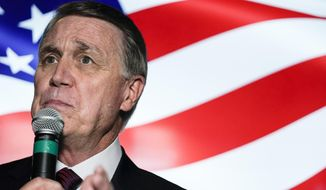 In this Friday, Nov. 13, 2020, photo, candidate for U.S. Senate Sen. David Perdue speaks during a campaign rally, in Cumming, Ga. Perdue is hoping years spent as one of Donald Trump's biggest defenders pays off in Georgia, a state the president lost in last month's election. Perdue and Georgia's other senator, Republican Kelly Loeffler, are both campaigning for Jan. 5 runoff elections that will decide control of the Senate. (AP Photo/Brynn Anderson) **FILE**