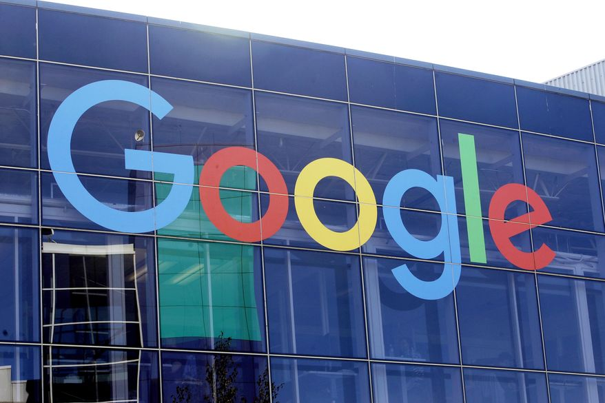 In this Sept. 24, 2019, file photo a sign is shown on a Google building at their campus in Mountain View, Calif. (AP Photo/Jeff Chiu, File)  **FILE**