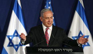 Israeli Prime Minister Benjamin Netanyahu speaks during a news conference with White House senior adviser Jared Kushner in Jerusalem, Monday, Dec. 21, 2020. (Ronen Zvulun/Pool Photo via AP)