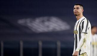 Juventus' Cristiano Ronaldo reacts during the Serie A soccer match between Juventus and Fiorentina, at the Allianz Stadium in Turin, Italy, Tuesday, Dec. 22, 2020. (Fabio Ferrari/LaPresse via AP)