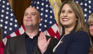 "FILE - In this Jan. 3, 2019, file photo, Rep. Katie Hill, D-Calif., and Hill's husband, Kenneth Heslep, pose during a ceremonial swearing in on Capitol Hill in Washington during the opening session of the 116th Congress. Former U.S. Rep. Katie Hill sued her ex-husband and two media outlets Tuesday, Dec. 22, 2020, for distributing ""nonconsensual porn"" without her consent that helped torpedoed her political career. Hill sued Kenneth Heslep, who she said launched a ""scorched earth attack"" on her life after she broke up with him, enlisting right-wing media and the Daily Mail. (AP Photo/Cliff Owen, File)"