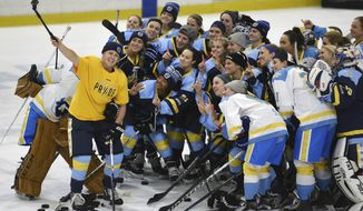 FILE - In this Jan. 24, 2016, photo, National Women's Hockey League All-Star players take time for a photo before an All-Star game at Harborcenter in Buffalo, N.Y. The National Women's Hockey League semifinals and final will air on NBC Sports Network in early February 2021. It will be the first time professional women's hockey games are shown live on a major television network in the U.S. (AP Photo/Gary Wiepert, File)