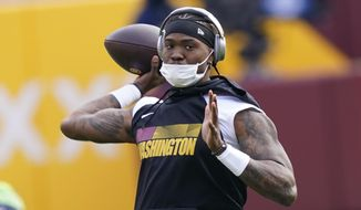 Washington Football Team quarterback Dwayne Haskins warming up before the start of an NFL football game against the Seattle Seahawks, Sunday, Dec. 20, 2020, in Landover, Md. (AP Photo/Susan Walsh)