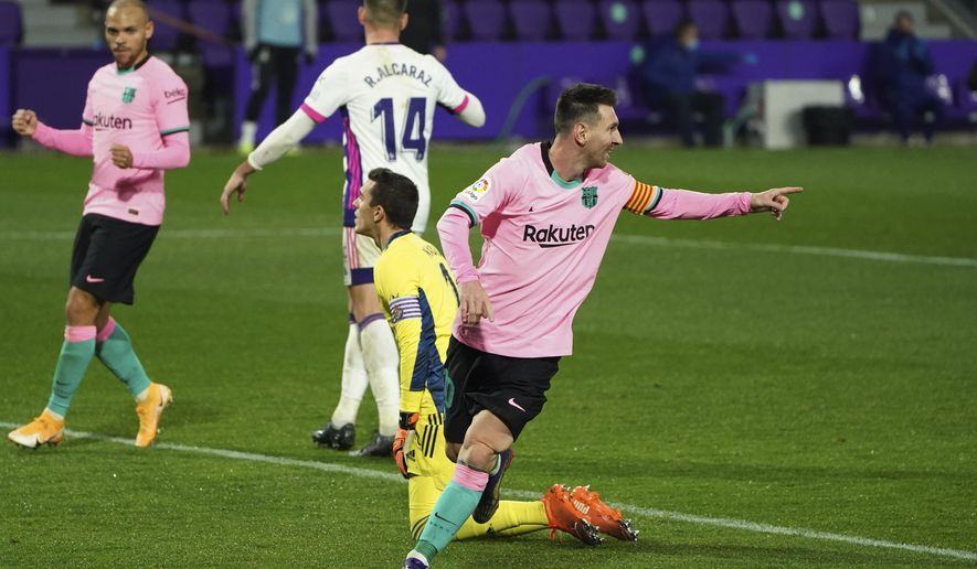 Barcelona's Lionel Messi celebrates after scoring his side's third goal during a Spanish La Liga soccer match between Valladolid and Barcelona at the Jose Zorrilla stadium in Valladolid, Spain,Tuesday Dec. 22, 2020. (Cesar Manso/Pool via AP)