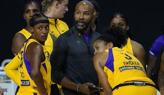 FILE - In this Sept. 17, 2020, file photo, Los Angeles Sparks head coach Derek Fisher talks to guard Brittney Sykes (15) and forward Candace Parker (3) during the second half of a WNBA playoff basketball game against the Connecticut Sun in Bradenton, Fla. The Sparks extended coach Derek Fisher's contract and appointed him the team's general manager on Tuesday, Dec. 22, 2020. (AP Photo/Chris O'Meara, File)