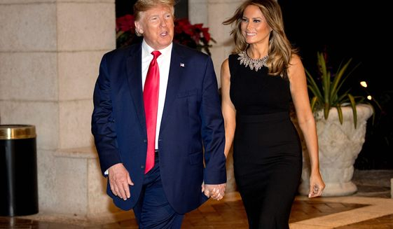One year ago: President Trump and first lady Melania Trump arrive for Christmas Eve dinner at Mar-a-Lago in Palm Beach, Florida. (Associated Press)