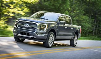 This photo provided by Ford Motor Co. shows the 2021 Ford F-150, a light-duty pickup truck with an upgraded interior, plus available hybrid and onboard generator options. (Ford Motor Co. via AP)