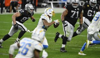Los Angeles Chargers cornerback Chris Harris (25) runs after making an interception against the Las Vegas Raiders during the second half of an NFL football game, Thursday, Dec. 17, 2020, in Las Vegas. (AP Photo/David Becker)