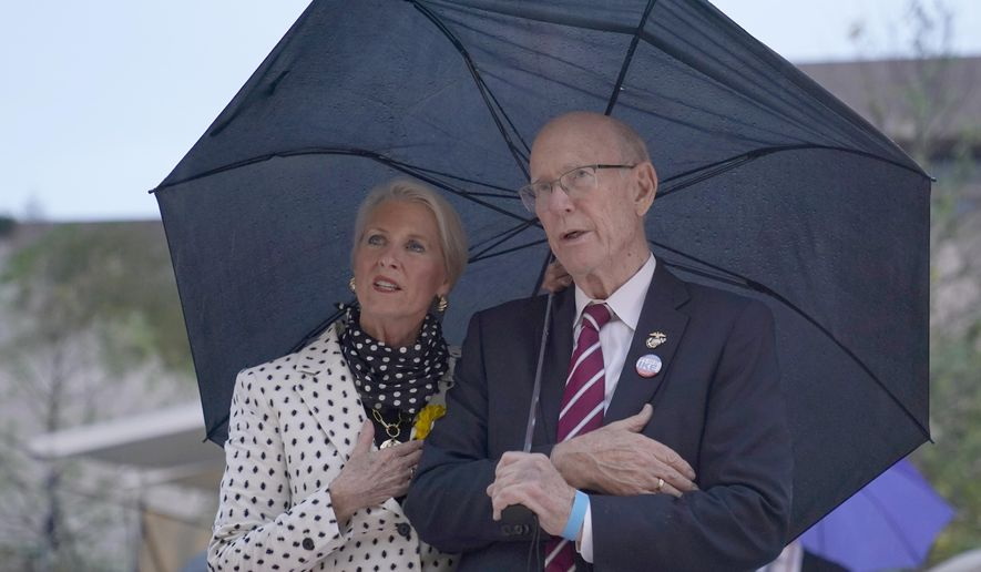 FILE - In this Sept. 17, 2020 file photo, Sen. Pat Roberts, R-Kan., and his wife Franki Roberts attend the dedication ceremony for the monument dedicated to Dwight D. Eisenhower, in Washington. Sen. Pat Roberts, delivered his farewell speech on the Senate floor Dec. 10, 2020 after 40 years in Congress. Roberts, is winding down a Washington career that spans ten presidencies, beginning in 1967 as an aide to two Kansas Republicans, Sen. Frank Carlson and later Rep. Keith Sebelius. (AP Photo/Susan Walsh File)