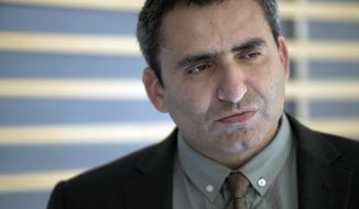 In this Sunday, May 26, 2013, file photo, Israeli Deputy Foreign Minister Zeev Elkin listens during an interview with The Associated Press, in Jerusalem. On Wednesday, Dec. 23, 2020, Elkin, a longtime confidant of Prime Minister Benjamin Netanyahu, announced he is quitting the ruling Likud party and joining an upstart political rival. (AP Photo/Dan Balilty, File)  **FILE**