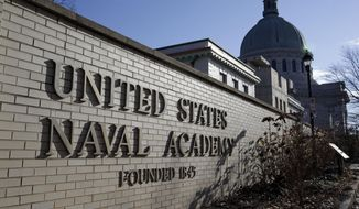 This Jan. 9, 2014, file photo shows a sign outside of an entrance to the U.S. Naval Academy campus in Annapolis, Md. (AP Photo/Patrick Semansky, File)